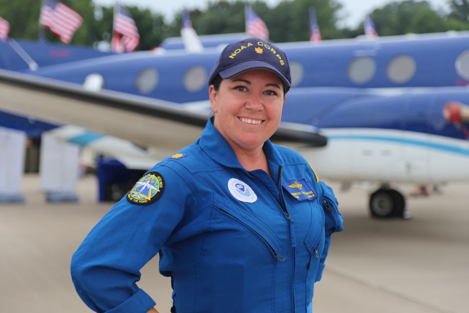 NOAA Corps officer Lt. Cmdr. Rebecca Waddington with NOAA's Beechcraft King Air 350CER emergency response and coast mapping aircraft, which was on display at the Experimental Aircraft Association AirVenture airshow in Oshkosh, Wisconsin, in July 2016.